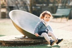 Free Outdoor Portrait Of Adorable Toddler Girl With Curly Hair Stock Photography - 212805422