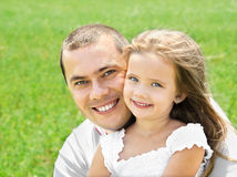 Outdoor Portrait Of Happy Smiling Young Man And Little Girl Royalty Free Stock Image