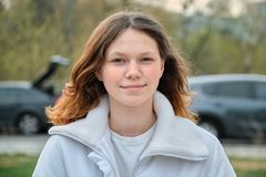 Free Outdoor Portrait Of Teenager Girl 15 Years Old, Girl Smiling With Long Brown Hair In White Jacket Royalty Free Stock Photo - 144645745