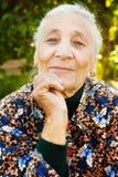 Outdoor portrait of one elegant senior woman stock photo