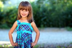 Outdoor portrait of optimistic smiling pretty little girl in blu Stock Images