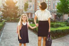 Outdoor portrait of parent and children on the way to school. Outdoor portrait of a parent and children on the way to school Royalty Free Stock Images