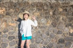 Outdoor portrait of a pretty asian girl in hat ,closeup of beaut royalty free stock image