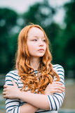 Outdoor portrait of pretty red-haired girl with green eyes Royalty Free Stock Images