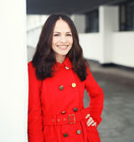 Outdoor portrait of pretty smiling woman dressed a red jacket Stock Images