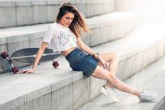 Outdoor portrait of pretty stylish fashion girl having fun stock image