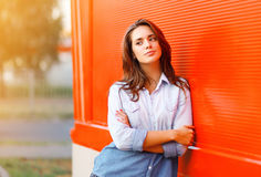Outdoor portrait pretty woman against colorful wall. In summer Royalty Free Stock Images