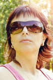 Outdoor portrait of pretty woman with reflection in sunglasses Royalty Free Stock Photos