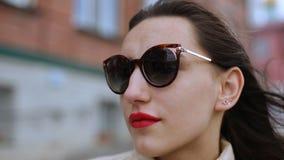 Outdoor portrait pretty woman in sunglasses in summer day.  stock video