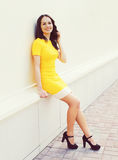 Outdoor portrait of pretty woman in yellow dress Royalty Free Stock Photos