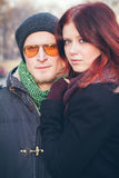 Outdoor portrait of pretty young couple. Outdoor closeup portrait of pretty young couple in love feeling happy together in cold weather Royalty Free Stock Photo