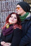 Outdoor portrait of pretty young couple in love. Outdoor closeup portrait of pretty young couple in love feeling happy together in cold weather Stock Photos