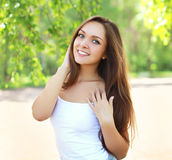 Outdoor portrait of pretty young girl in sunny summer Stock Photo