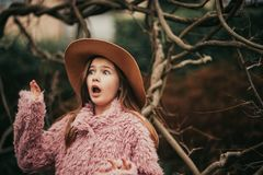 Outdoor portrait of pretty young kid girl stock photo