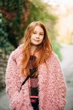 Outdoor portrait of pretty young red-haired girl stock photography