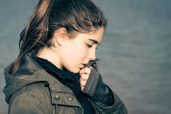 Outdoor portrait in profile of a thoughtful teenage girl Stock Image