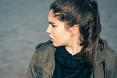 Outdoor portrait in profile of a thoughtful teenage girl Stock Photography