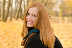 Outdoor portrait of red haired girl with green eyes Royalty Free Stock Photo