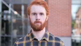 Outdoor Portrait of Redhead Beard Young Man. 4k high quality, 4k high quality stock video