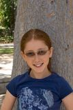 Outdoor portrait of redhead girl in glasses Royalty Free Stock Photos