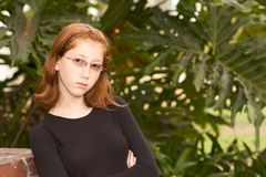 Outdoor portrait of redhead teen girl in glasses Royalty Free Stock Photography