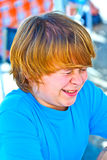 Outdoor portrait of relaxed cute boy. Outdoor portrait of relaxed cute young boy looking positive and friendly Stock Photo