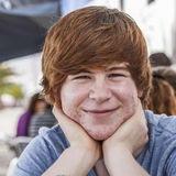Outdoor portrait of relaxed cute young boy. Looking positive and friendly Royalty Free Stock Photos