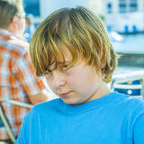Outdoor portrait of relaxed cute young boy. Looking positive and friendly Stock Images