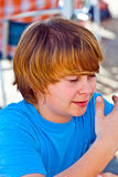 Outdoor portrait of relaxed cute young boy. Looking positive and friendly Stock Photos