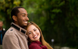 Outdoor portrait of romantic and happy interracial young couple in park Stock Photo