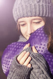 Outdoor portrait of sensual young girl with violet heart in her hands Royalty Free Stock Photo