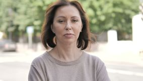 Outdoor Portrait of Serious Old Woman stock footage
