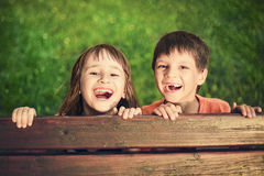 Outdoor portrait of smiling girl and boy. Who lost his milk teeth Stock Photography