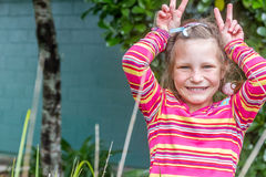 Outdoor portrait of smiling happy child girl royalty free stock image