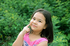 Outdoor Portrait of a Smiling Little Girl Stock Image