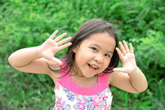 Outdoor Portrait of a Smiling Little Girl Stock Photos