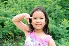 Outdoor Portrait of a Smiling Little Girl Stock Photo