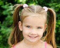 Outdoor portrait of smiling little girl Royalty Free Stock Images