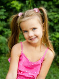 Outdoor portrait of smiling little girl Stock Photography