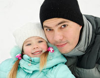 Outdoor portrait of smiling little girl with father Stock Image