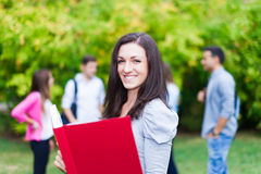 Outdoor portrait of a smiling student Stock Photo