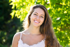 Outdoor portrait of smiling woman Royalty Free Stock Photos