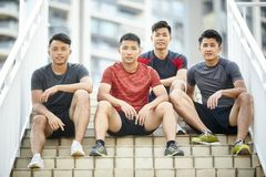 Outdoor portrait of four young asian athletes royalty free stock photo