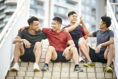 Outdoor portrait of four young asian athletes royalty free stock images