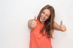 Outdoor portrait of teenage girl  showing thumbs up Royalty Free Stock Photos