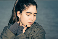 Outdoor portrait of a thoughtful teenage girl Royalty Free Stock Image
