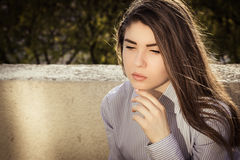 Outdoor portrait of a thoughtful teenage girl Royalty Free Stock Photos