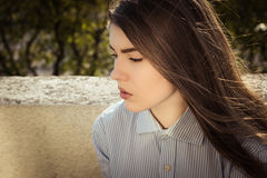Outdoor portrait of a thoughtful teenage girl Royalty Free Stock Images