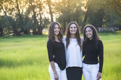 Outdoor Portrait of three beautiful Hispanic women standing together outdoors royalty free stock photo