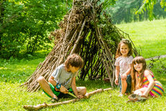 Outdoor portrait of three happy kids - boy and girls - playing n Stock Images